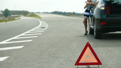 red-warning-triangle-with-a-broken-down-car